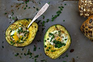 Baked avocado with eggs and chives.