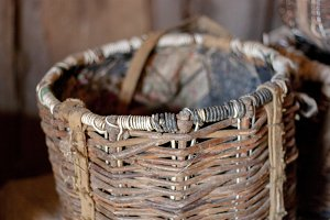 Old wicker straw basket close-up