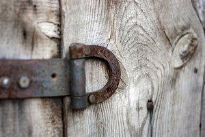Rusty old door hinge close-up