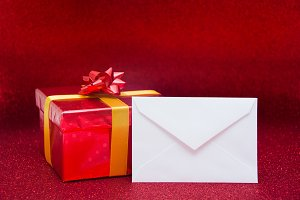 Red gift box and white envelope