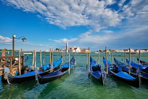 Gondolas and in lagoon of Venice by