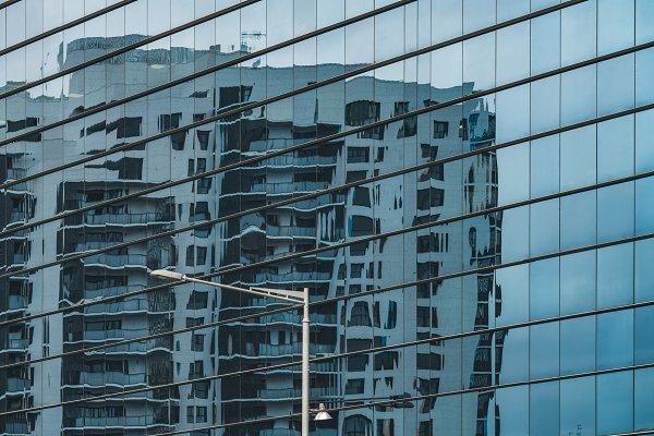 Stock Photos: Visual Motiv - Building reflected on a glass facade
