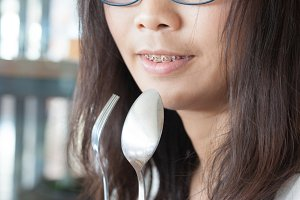 Asia woman hold spoon and fork