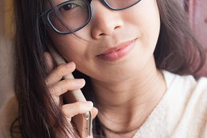 asia woman talk phone.