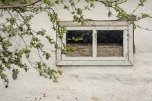Old window on the white wall by  in Architecture