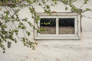 Old window on the white wall