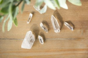 Quartz and Greenery on wood table