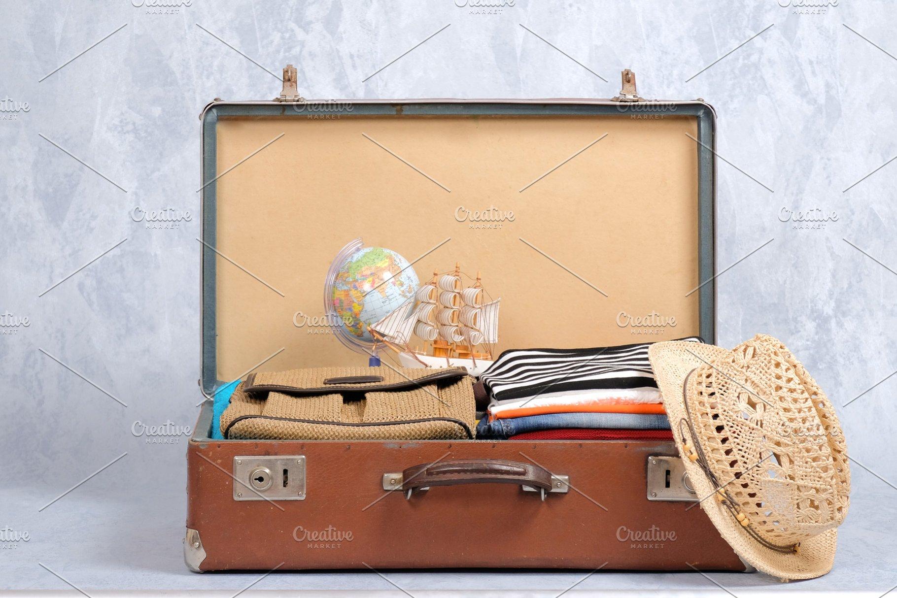 e6aef60b7f428 Full travel suitcase on grey backgro ~ Holiday Photos ~ Creative Market