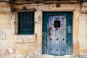 Old green painted door in stone