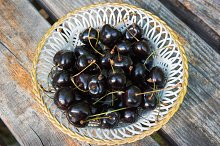 White plate of ripe black cherries by  in Food & Drink