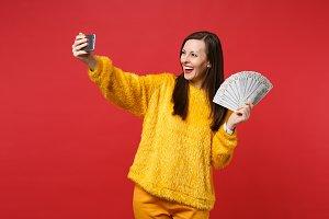 Laughing young woman doing selfie sh