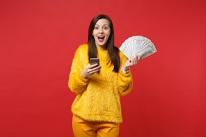 Excited young woman in yellow fur sw