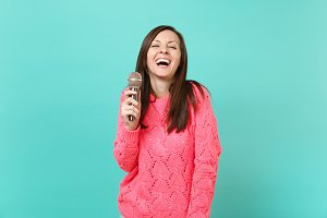 Laughing funny young woman in knitte