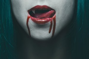 Vampire lips in blood close-up