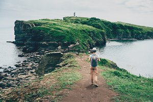 Tourist girl walking on island