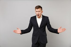 Shocked outraged young business man