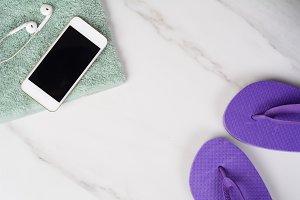 Smartphone, flip-flops and towel.