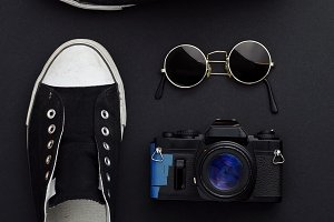 Sneakers, camera, and sunglasses