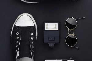 Sneakers, camera and sunglasses