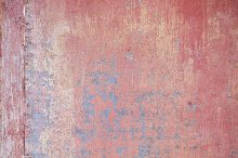 Detail of old red metallic wall