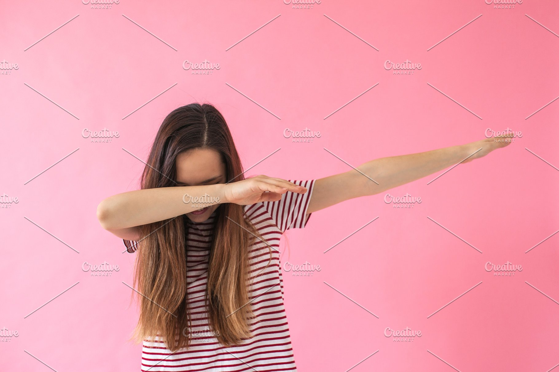 Young girl doing dab dance gesture
