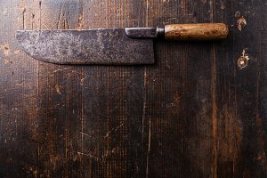 Meat cleaver on wooden background
