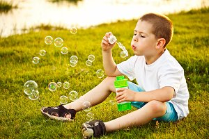 Boy and soap bubble