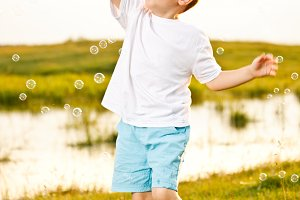 Boy Chasing Bubbles