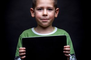 Boy showing tablet