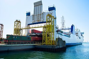 Unloading industrial cargo ship