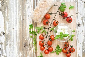 Branch of cherry-tomatoes with bread