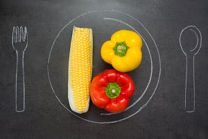 Corn and peppers on slate table