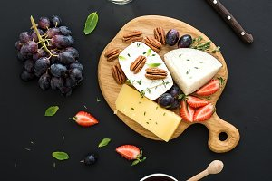 Variety of cheese, grapes and pecan