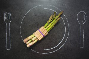 Asparagus on slate table.