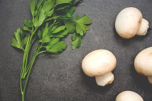 Mushrooms and parsley on slate table