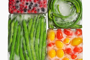 frozen vegetables and berries in ice