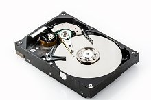 Open hard disk isolated on white