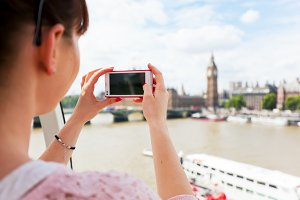 Young woman taking picture of London