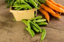 Fresh green peas and carrots