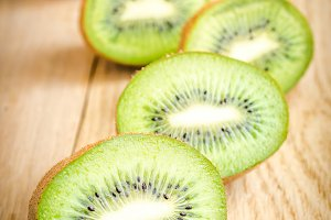 Kiwi on the wooden background