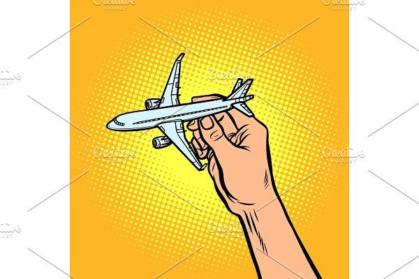 passenger plane in hand. metaphor of