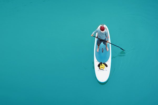 People Images - Man Paddling on SUP board