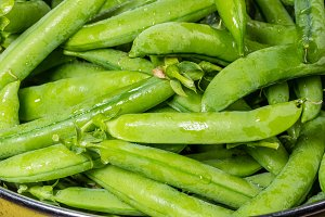 Fresh green peas in bowl