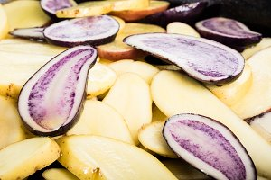 Sliced blue and white potatoes