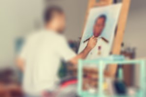 Blur of artist painting portrait