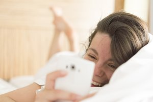 Relaxed young woman with mobile phon