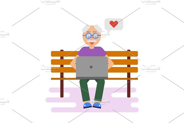 Old man texting on laptop