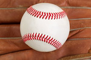 Baseball and mitt in full frame