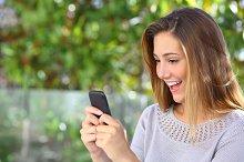 Beautiful woman browsing internet happy in her smart phone.jpg