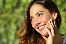Beauty woman with a perfect smile and white tooth.jpg